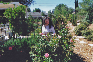 Photo of Gabriele tending to her roses